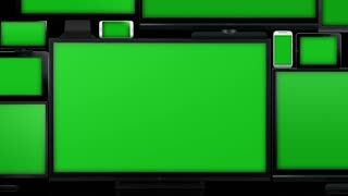 Many different types of screens. TVs, computer monitors, smartphones and tablets. They laid on each other in a pile isolated on a white background. They are all with a green screen. Zoom out. With alpha.