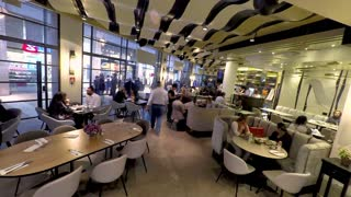 Jerusalem, Israel - May 11, 2017: Timelapse of people enjoying at cafe. They sitting near tables, eating and drinking.