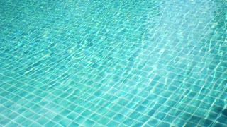 Abstract Background of Sparkling Blue Water in a Swimming Pool