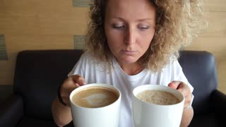 Addicted Woman with Two Cups of Coffee