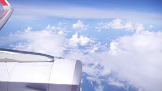 Airplane Flying in Sky with Turbine Closeup in Sunny Day