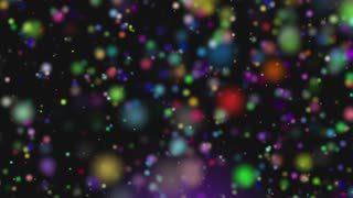 Animation of colorful sphere orbs falling and bouncing over the black surface. Colorful snow falling.