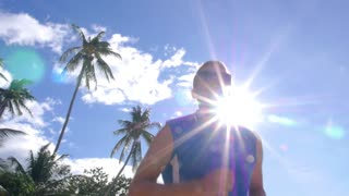 Athlete Running Man Jogging on Beach in Summer