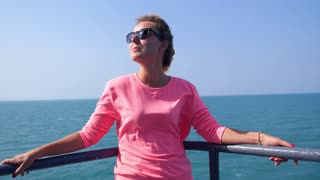 Attractive Girl Enjoying Sunny Day on Yacht Deck in Sea