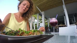 Attractive Woman Eating Salad at Cafe. Healthy Vegetarian Meal