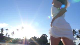 Beautiful Bride Girl in White Dress Running on Beach to Sun