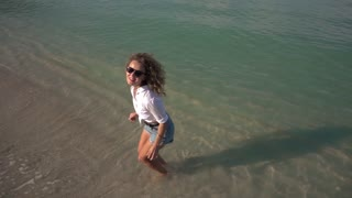 Beautiful Girl Jumping on Beach. Vacation Concept. Slow Motion.