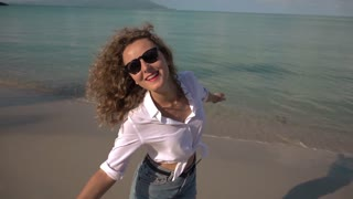 Beautiful Girl Laughing on Beach on Vacation. Slow Motion.