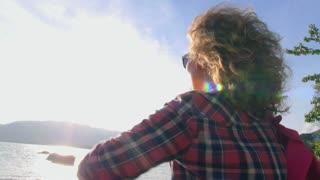 Beautiful Girl on Beach Looking at Sunset