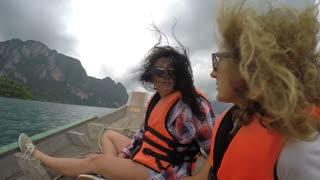 Beautiful Girls Friends in a Boat Having Fun. Slow Motion.
