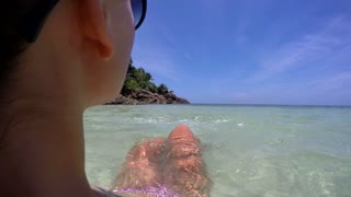 Beautiful Woman on Beach Relaxing in Sea on Vacation. 4K