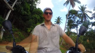 Biker Riding Fast on Motorbike on Jungle Road. Time Lapse