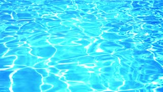 Blue Swimming Pool Rippled Water Detail. Slow Motion.