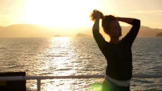 Blur Silhouette of a Young Woman Playing with Her Hair at Sunrise Sailing on a Yacht. Slow Motion.