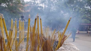 Burning of Incense Sticks at Buddhistic Temple