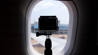 Camera Filming from Illuminator Window of Airplane