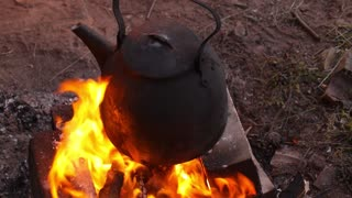 Camping Kettle Over Burning Fire