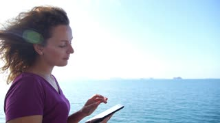 Carefree Cheerful Woman Uses Touchpad Tablet Technology