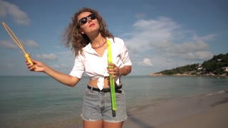 Carefree Woman Dancing with Bubbles on Beach. Slow Motion. 250fps