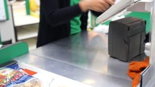 Cashier at Cash-desk in Supermarket