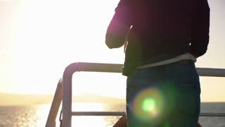 Casual Style Girl Admiring Beautiful Seascape during Sunrise from the Ship. Slow Motion