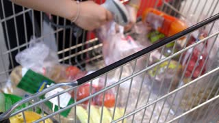 Checkout Lane with Shopping Trolley in Supermarket