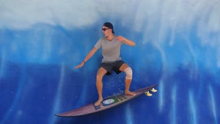 Cheerful Surfer Having Fun on Fake Surfboard. Funny Surfing