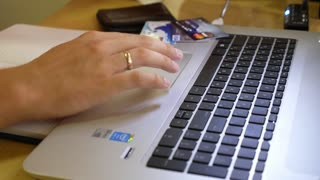 Close-up Of A Man Using Laptop with Credit Cards