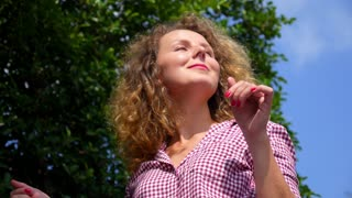 Close up of an Attractive Cheerful Woman Dancing in Sunny Day