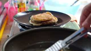 Close up of Cooking Pancakes on Hot Frying Pan for Breakfast.