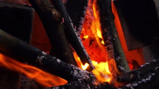 Close up of Fire and Firewood Burning in Fireplace