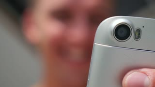 Close up of Laughing Man Using Mobile Phone