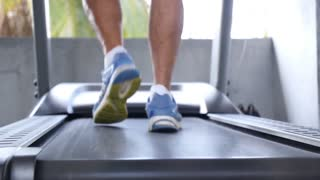 Close Up Of Male Legs Walking On Treadmill in Sport Gym