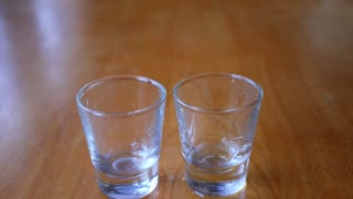 Close-up of Vodka Poured into a Shot Glass