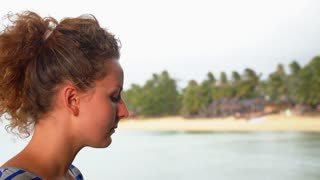 Close up of Woman Drinking Water against Sea Beach.