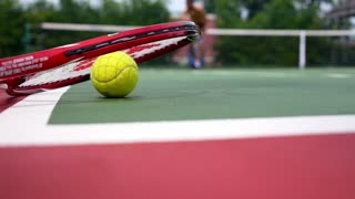 Close up View of Tennis Racket and Ball on Tennis Court.
