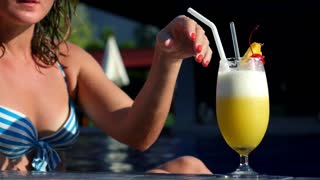 Close Up Woman Hand Holding Fruit Cocktail At The Beach Pool