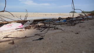 Closeup Beach Pollution. Garbage on the Beach. Slow Motion.