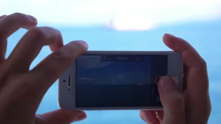 Closeup Hands Make Video of Sailing Boat by Cellphone. Slow Motion.
