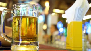 Closeup of Cold Pint of Beer on Bar Counter