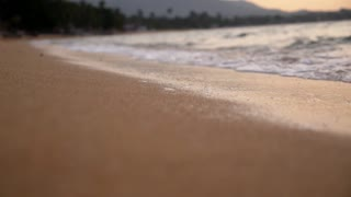 Closeup of Sand Beach with Sea Waves. Slow Motion.
