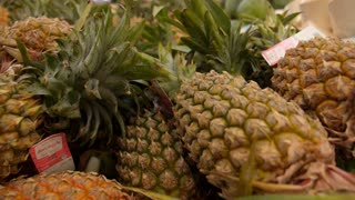 Closeup Pineapples (Ananases) at Fruit Market.