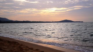 Colorful Dawn over the Sea. Calm Serene Beach. Slow Motion.