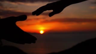 Couple Holding Hands in Sunset against Sea. Slow Motion.