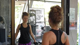 Cute Woman Lifting Weights in Gym. Healthy Working Out