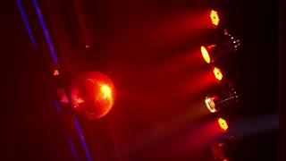Disco Ball Sparkling with Colorful Lights in Night Club