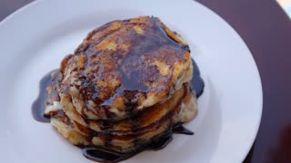 Eating a Stack of Chocolate Pancakes with Chocolate Topping