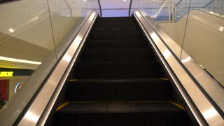 Escalator in a Shopping Mall. Slow Motion.