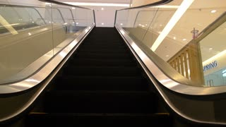 Escalator in Modern Office Building. Slow Motion.