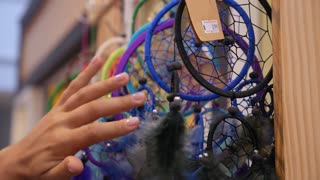 Female Hand Touching Dreamcatcher - Shopping for Souvenirs